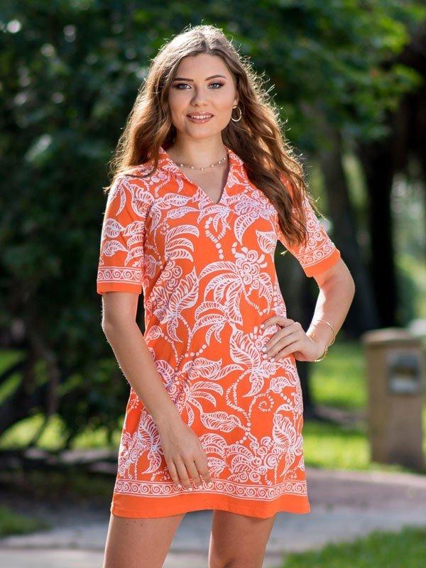 Woman wearing a stylish printed cotton knit polo dress