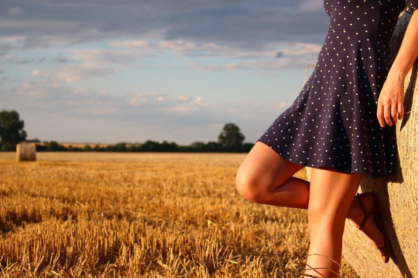 A woman wearing a cute summer dress