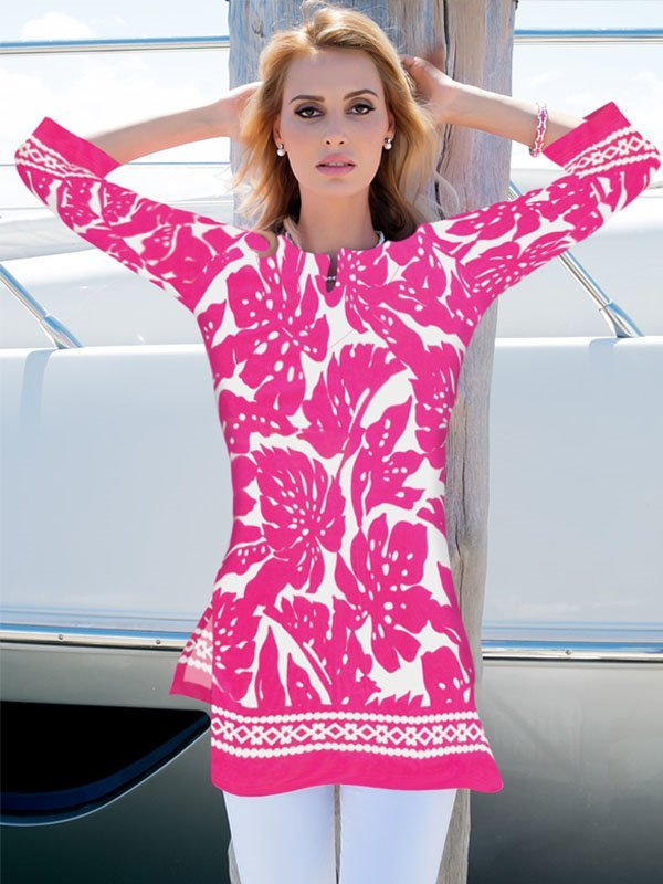 A woman wearing a gorgeous tunic dress while on a vacation