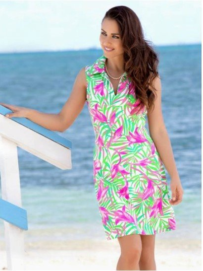 A woman wearing one of our summer dresses at the beach.