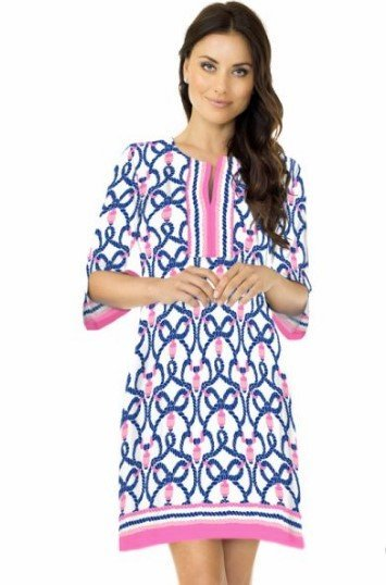 A model wearing a comfortable tunic-style dress that is light and breezy.