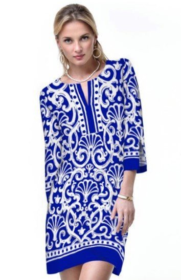 A model poses in a simple printed blue and white dress that is ideal for vacations.