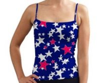 A model wearing a blue printed tank top with red and white stars, making it a fun look for the 4th of July.