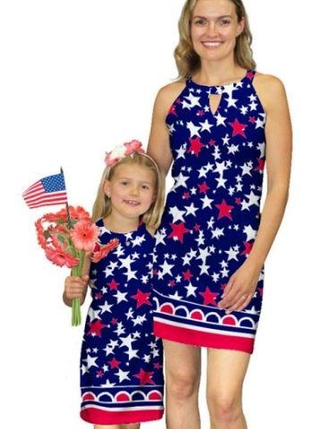 A mother and daughter in matching 4th of July themed dresses.