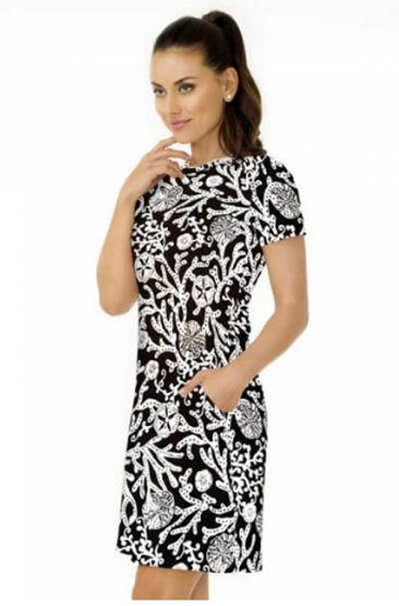 A model wears a summery black dress with a gorgeous white print over it.