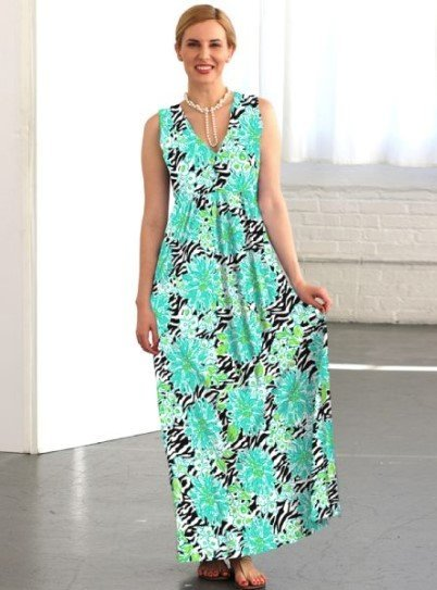 A woman in a modest full-length maxi dress that is perfect for vacations.