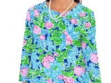 A woman wears a printed modest tunic that looks great on vacation.