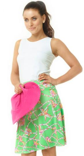 A plain tank top paired with a brightly printed skirt and a pink hat.